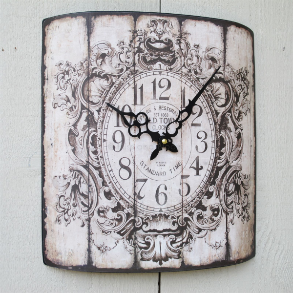 French style wall clock. Vintage style curved face with an antiqued ...