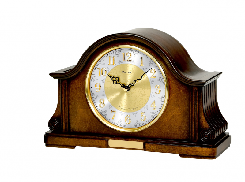 This Bulova Chadbourne Mantel Chime B1975 clock features a wood case ...