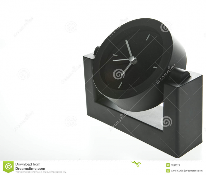 Modern and stylish desk clock in black with silver hands on a white ...