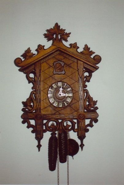 Press An antique cuckoo clock, created by the American Cuckoo Clock ...