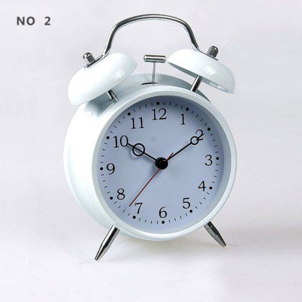 ... Quartz Analog Twin Bell Alarm Clock with Nightlight and Loud Alarm