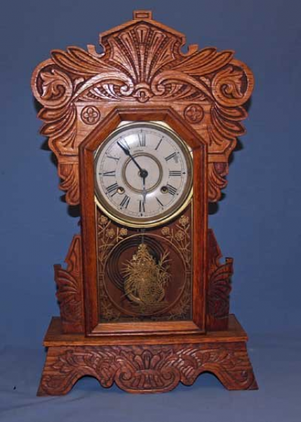 215: OAK GINGERBREAD CLOCK WITH PENDULUM (NEW HAVEN)