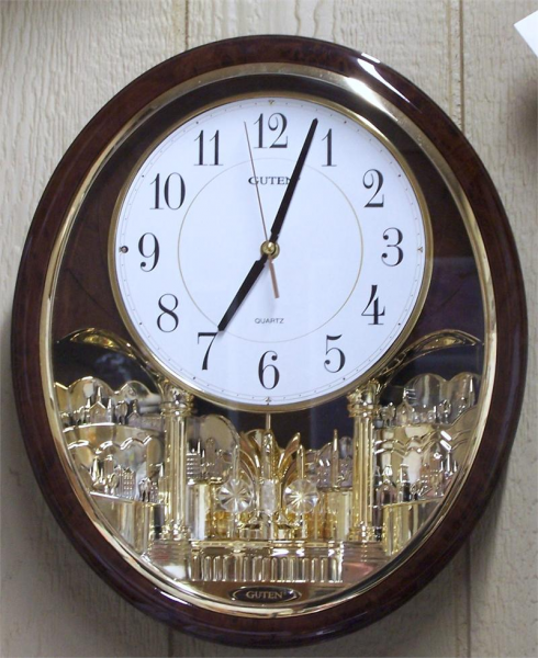 Guten Quartz Oval Rotating Pendulum Melody Wall Clock