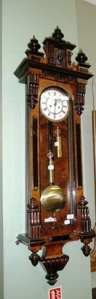 ... weight driven Vienna type wall clock with two weights and pendulum