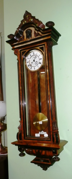 ... type double weight driven wall clock with two weights and pendulum