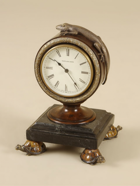 Maitland-Smith's forte is in small desk clocks loaded with detail ...