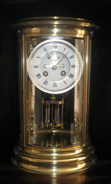 ... 19th century French oval four glass mantel antique clock circa 1880