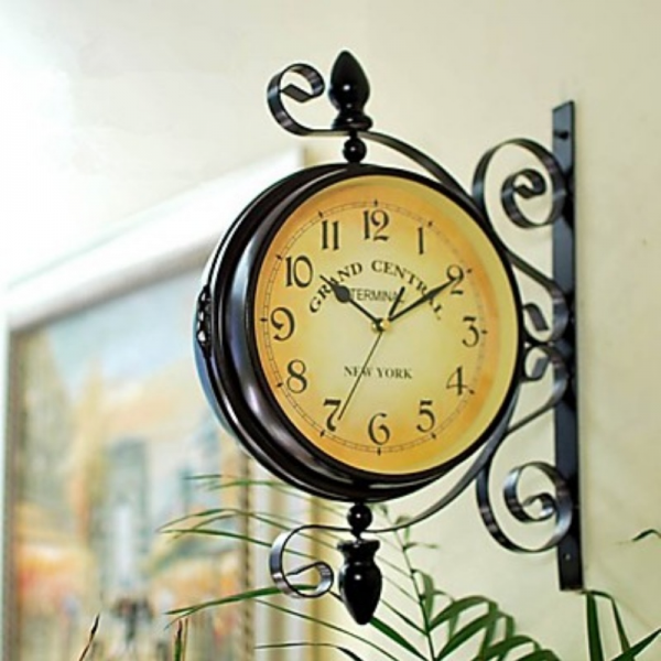 ... vintage style wall clock has a two sided design with a clock face