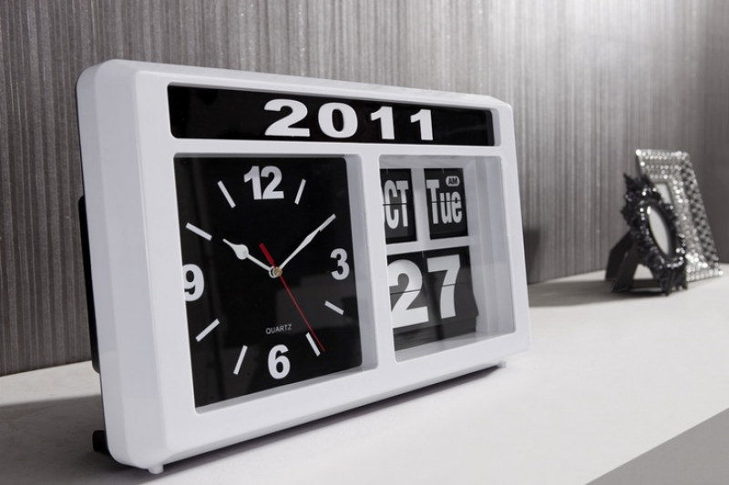 sleek wall clock. The Retro auto flip clock features the month, day ...