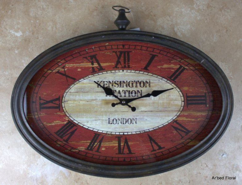 20 Kensington Station London Oval Wall Clock Glass Faced Metal Edging ...