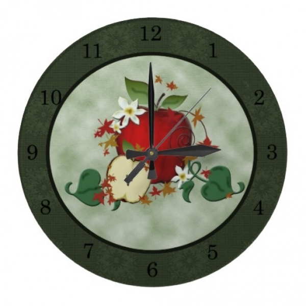 Red Apple and Blossoms Wall Clock A bright red apple with a smaller ...