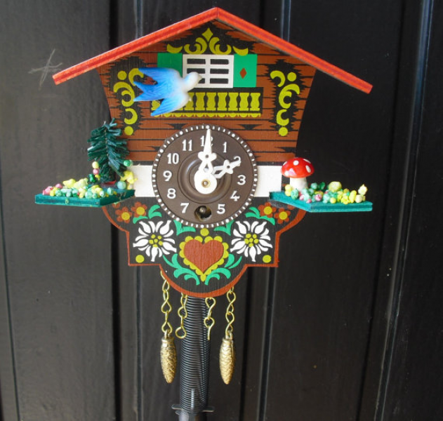 Cute German cuckoo clock with swinging girl- Black Forest clock ...