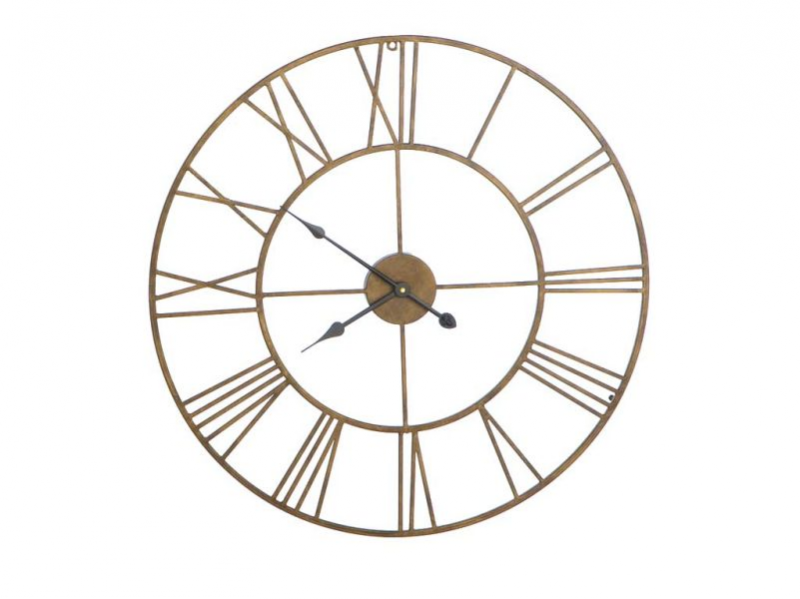 oversized wall clock has an open back and roman numerals on the face