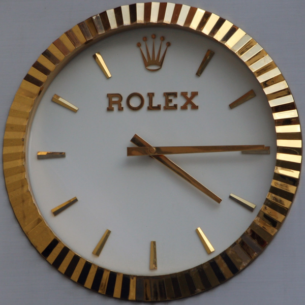Fake Rolex wallclocks and the authentic Rolex wallclock | exitwatch24 ...