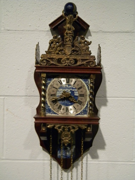 United Clock Works Wall Clock with Dutch Scene on Dial