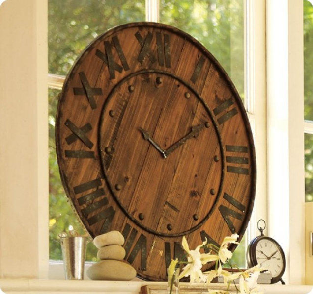 ... came from the Rustic Wood and Iron Clock from Pottery Barn
