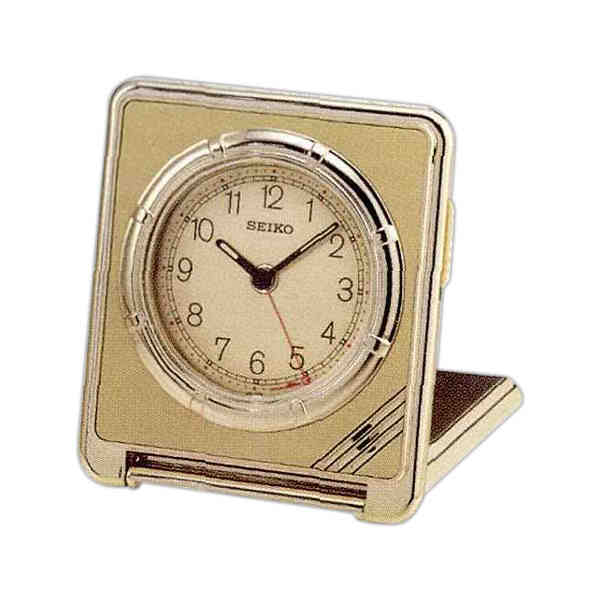 Travel alarm clock with ultra thin gold tone case. Easy to set front ...