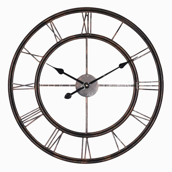 large metal wall clock with roman numerals and ornate hands