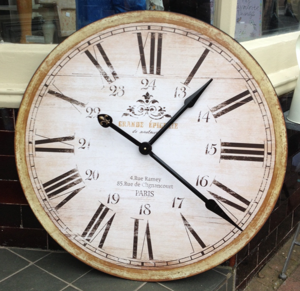 This very large wooden wall clock has been distress painted in cream ...