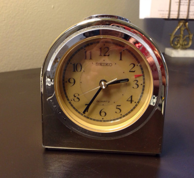 vintage gold-tone alarm clock. by seiko. battery operated.