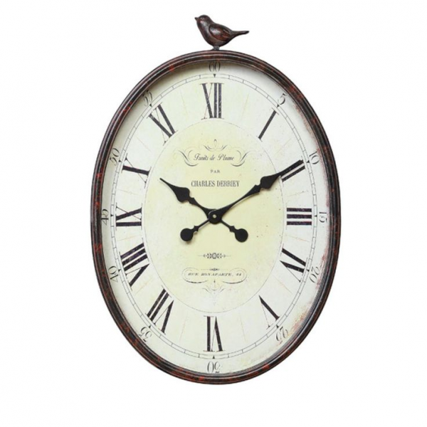 On Wall In Bathroom #2 Above White Tub / Metal Oval Bird Wall Clock