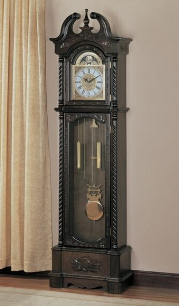 Brown finish wood grandfather clock with decorative crown and twisted ...